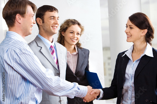 Business people are shaking hands confirming a sale