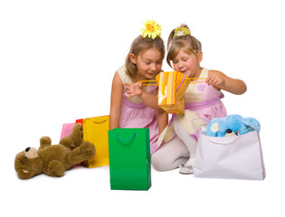 children consider gifts with delight over white background