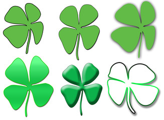 A collection of different green four leaf clovers