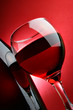 roleta: Still-life with glass of wine over red background
