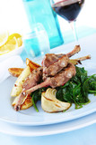 Grilled lamb cutlets on wilted garlic spinach.  poster