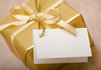 golden gift box with empty card close up shoot