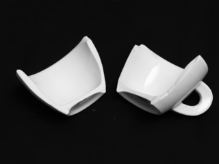 broken coffee cup on black background