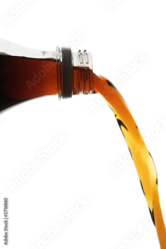 pouring cola drink from bottle