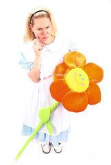blond little girl with a giant orange sun flower thinking