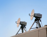 telecommunications - two satellite parabolic antenna poster