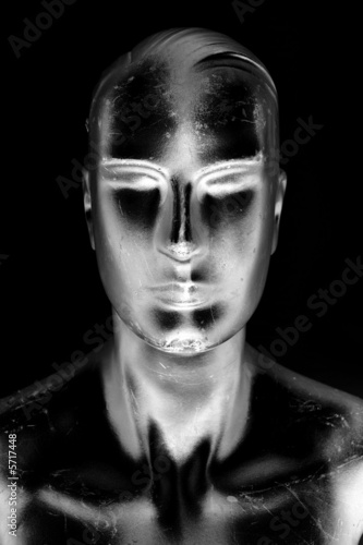 futuristic manikin man in silvery shadows of black