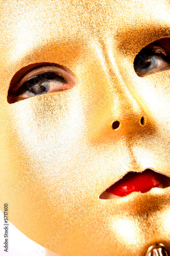 golden mask on a stick for a masquerade ball