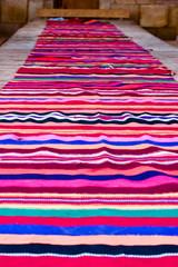 Self-made striped carpet in habitation of nomads