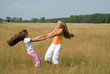 Girls plays on a meadow II