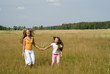 Girls plays on a meadow