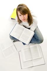 Portrait of Happy young schoolgirl reading books