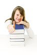 Portrait of Happy young schoolgirl reading book