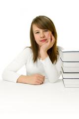 Portrait of Happy young schoolgirl reading book