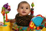 Beautiful 3 month Hispanic baby playing with toys. poster