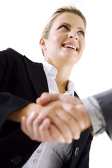 happy business woman shaking hands