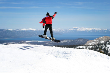 Snowboarder enjoying a view at Lake Tahoe, California