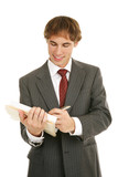 Handsome young businessman reviewing a good report.  poster