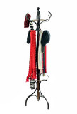 Vintage coat rack with winter hats and scarves.   poster