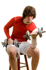 A young man lifting weights over a white background.