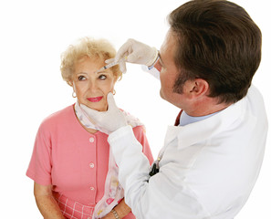Senior woman having cosmetic injections to fill in wrinkles.