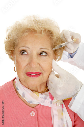 poster of Woman receiving cosmetic injections for facial rejuvenation.