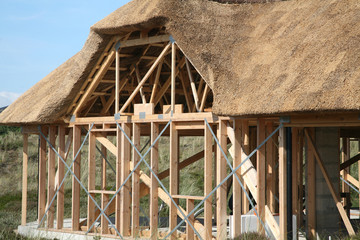 construction of half timberedhouse   with. thatched  roof