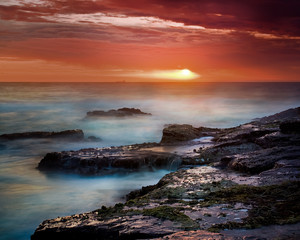 Sunrise on East Coast of Australia, with ship on the horizon