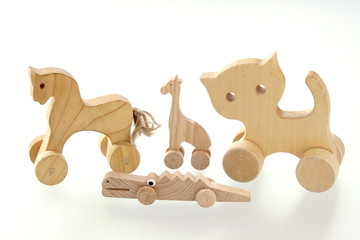 Wooden toys isolated on white background