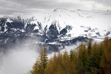winter scene: french Alps on a foggy day