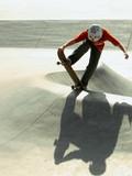 Kid on skate board doing tricks poster