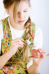 Young girl painting eggs for oyster