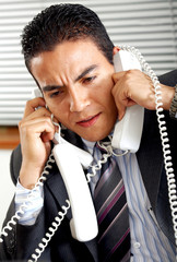 busy business man with many telephones at once