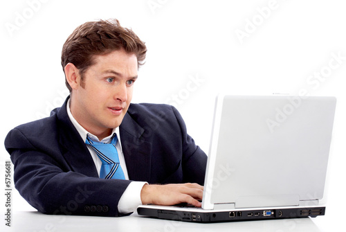 business man working on a laptop with a slightly