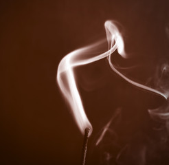 studio close up of a smoke coming off a match