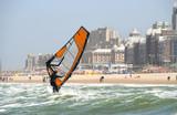 Wind surfer with backdrop of Scheveningen resort in Holland poster