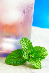 Closeup of mint leaves and tropical cocktail