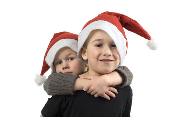 Two brothers with Christmas hats. On white background.