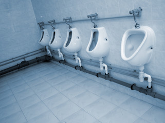 Row of urinals in a public WC