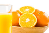 Oranges with a glass of orange juice in the foreground poster