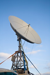 broadbrand satelite dish on blue sky background