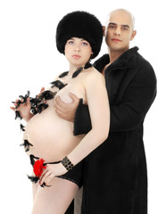 picture of pregnant woman and her man wearing black fur