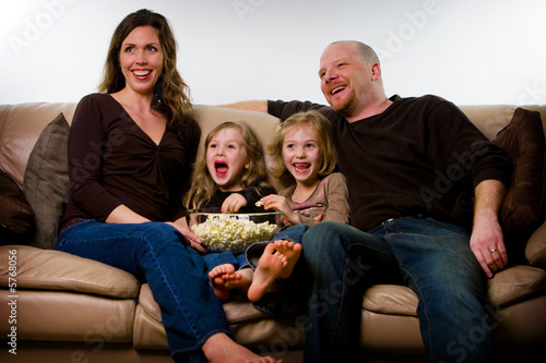 Happy Family watching TV Poster