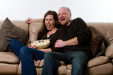 Couple watching scary movie poster