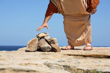 Man picking up stone.  Concept - Sin, punishment