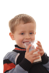4 years old boy and glass of milk isolated on white