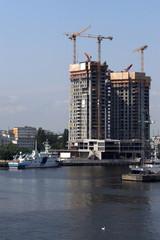 Skyscraper and cranes