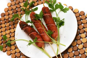 Grilled sausages on dish