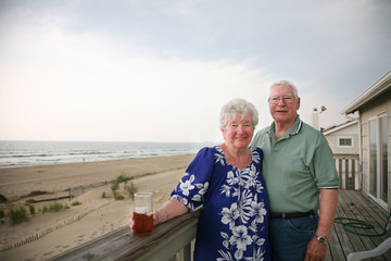 Happy senior couple on vacation overlooking the ocean