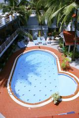 swimming pool inside resort, kerala, india